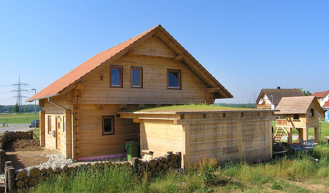 Duffner blockbau stoeckig mit flachdach pic source anbau for Klassisches haus bauen